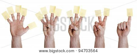 five hands holding sticky