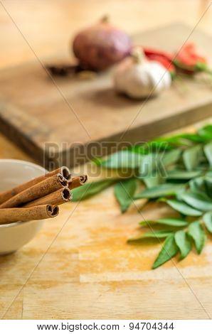 Cinnamon Sticks On A Sauce Bowl