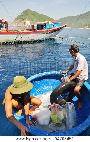 Nha Trang, Vietnam - May 4, 2012: Transferring Supplements From Land To Fishing Boats In The Sea Of