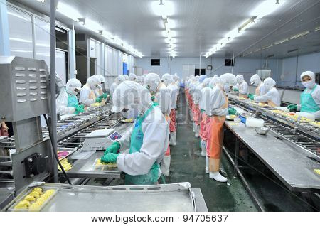 Ho Chi Minh City, Vietnam - October 3, 2011: Workers Are Working Hard On A Production Line In A Seaf