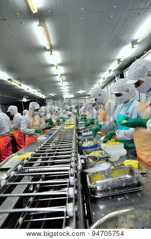 Ho Chi Minh City, Vietnam - October 3, 2011: Workers Are Working Hard On A Production Line In A