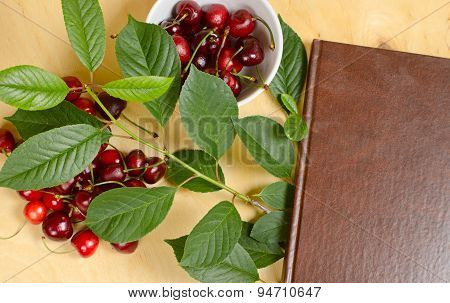 Sweet Cherry And Notebook For Daily Records