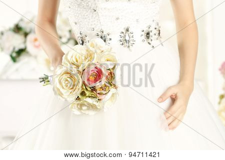 Hands Of A Bride Holding A Beautiful Bouquet