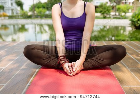 Sitting in yoga position