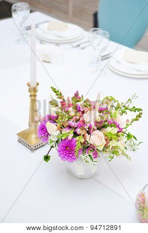 Table Set For An Event Party Or Wedding Reception With Candle And Flowers