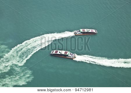 Two passenger ships passing by