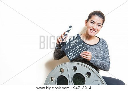 Young Woman With Movie Clapper And Cinema Reel On White