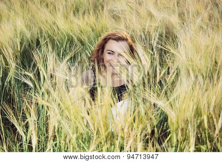 Young Crazy Woman In The Wheat Field
