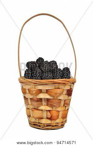 Wooden basket with blackberries