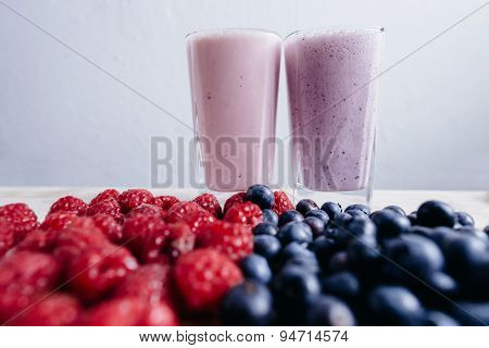 Rapsberry And Blueberry Smoothie With Fresh Berries On Wood Table