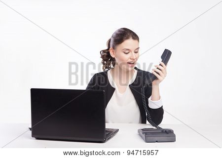 Portrait of worried businesswoman talking on the phone