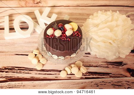 Chocolate Cake With Love Letters On A Wooden Table