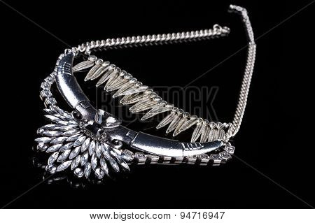 metallic necklace in the form of feathers