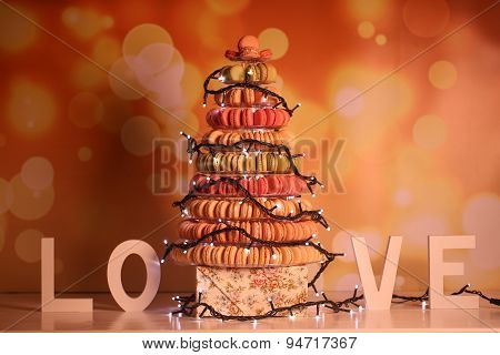 Pyramid Of Macaroons With Lights And Love Letters