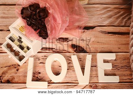 Mini Chocolate Sweets And Love Letters On Table