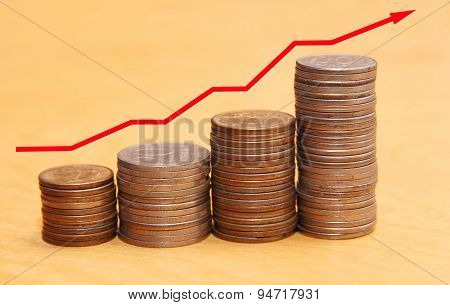 Stacks Of Coins And Red Arrow Representing Finance Growth.