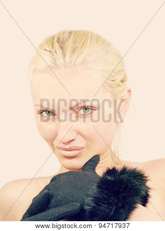 Young Playful Pretty Women In Black Furs Gloves Looks At Camera.