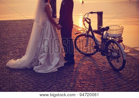 Bride And Groom In Sunset Light