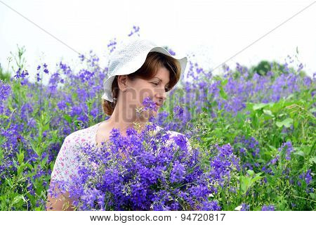 Woman With A Bouquet Of Wild Flowers On The Lawn