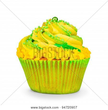Yellow Birthday Cupcake With Green Cream On Isolated White Background