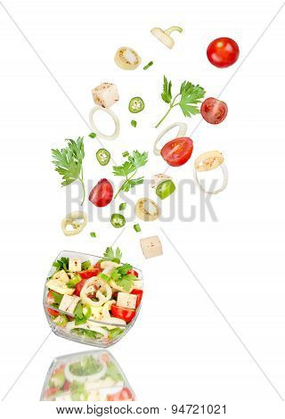 Fresh Salad. Mixed Falling Vegetables In Bowl On White Background