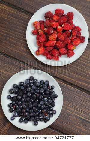 Blueberries And Strawberries On A Plate