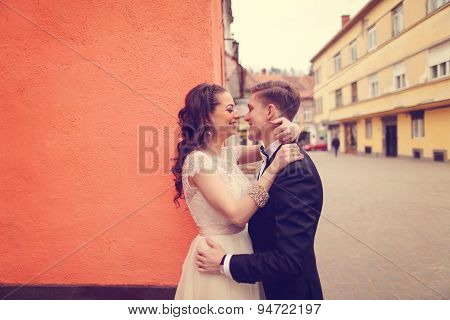 Bride And Groom Embracing In The City