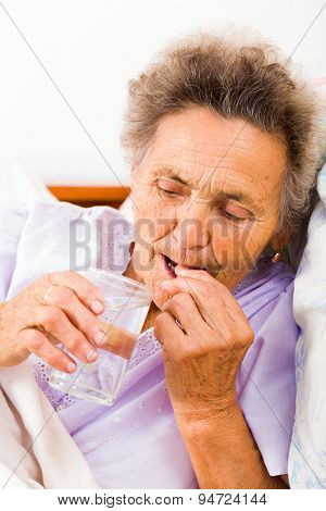 Elderly Woman With Pills