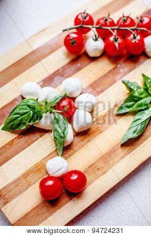 Cherry Tomatoes With Minimozzarella And Basil
