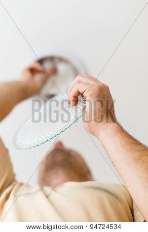 Repairman Fixing
