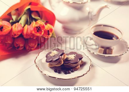 Delicious Cake With Coffe And Tulips On Table