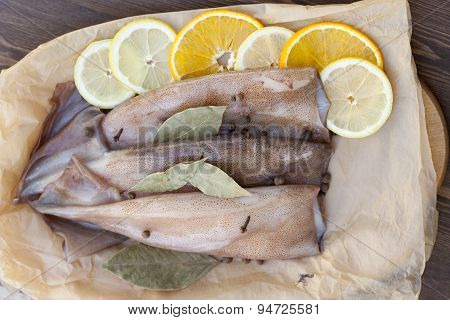 Fresh squid carcass with spices on paper