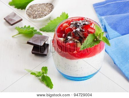 Chia Seed Pudding With Berries And Chocolate On  White  Wooden Table.