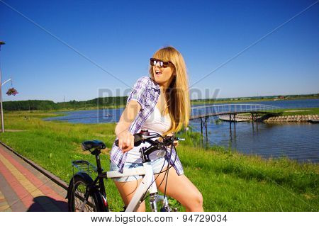 Portrait Of A Young Woman On Bicycle