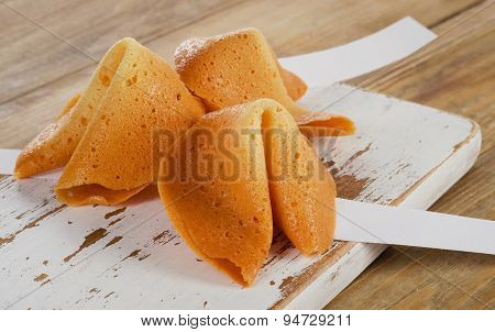 Fortune Cookies  On  A Wooden Board.