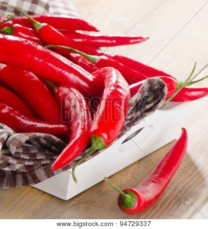 Red Chili Peppers In  White Wooden Box.