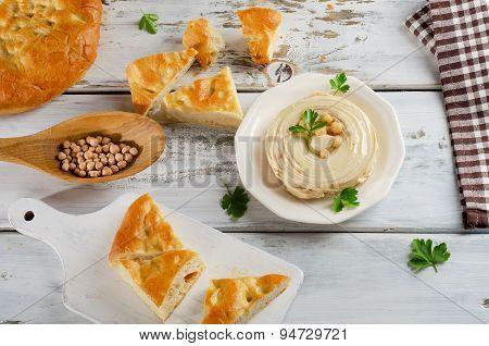 Plate Of  A Creamy Hummus With Pita.