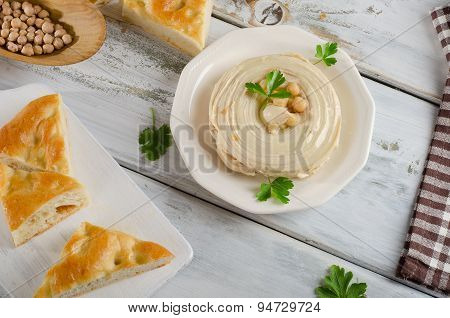 Plate Of  A Creamy Hummus With Pita And Parsley.