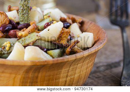 Warm salad from potato and mushrooms