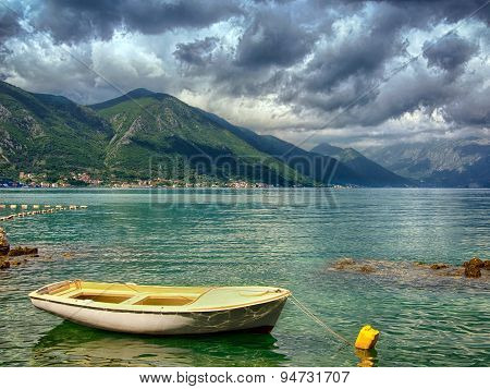 pier with boat in Montenegro. Amazing mountain landskape