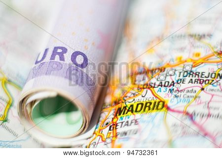 Euro Banknotes On A Geographical Map Of Madrid