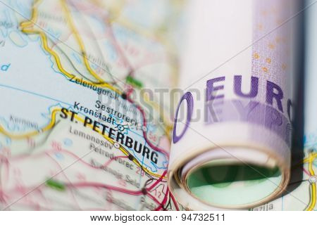 Euro Banknotes On A Geographical Map Of Saint Petersburg