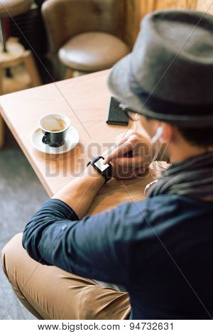 Checking His Smartwatch