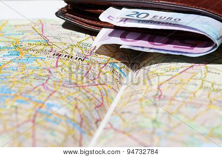 Euro Banknotes Inside Wallet On A Geographical Map Of Berlin