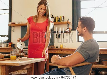 Smiling Woman Serving Breakfast To Her Boyfriend