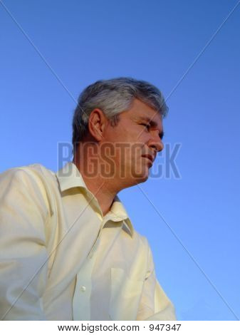 Middle-Aged Man Looking Into The Distance
