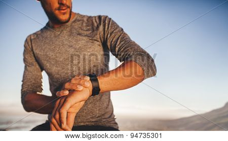 Young Runner Checking The Time On His Wristwatch