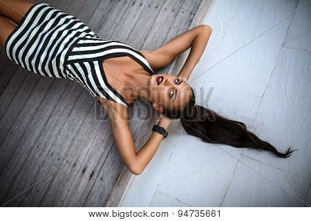 Beautiful girl in bright striped dress