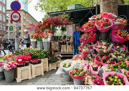 Rotterdam, Netherlands - May 9, 2015: People At Flower Shop In Rotterdam