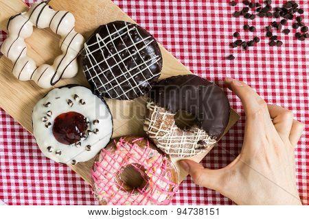 Hand Taking Doughnut Or Donut During Coffee Break